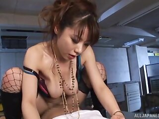 Provocative Japanese chick in fishnet gives a blowjob and rides