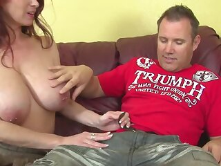 Red-haired seductress with amazing big jugs is good at handjob